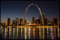 Arch, Old Courthouse and skyline reflected in Mississippi River at night. Gateway Arch National Park ( color)