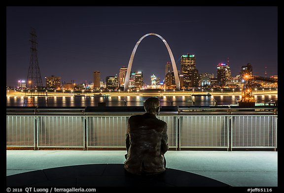 St Louis skyline and Malcom Martin statue from Mississippi River Overlook at night. Gateway Arch National Park (color)