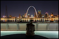 St Louis skyline and Malcom Martin statue from Mississippi River Overlook at night. Gateway Arch National Park ( color)