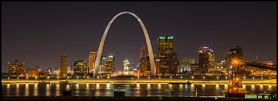 St Louis skyline from Mississippi River Overlook at night. Gateway Arch National Park (Panoramic color)