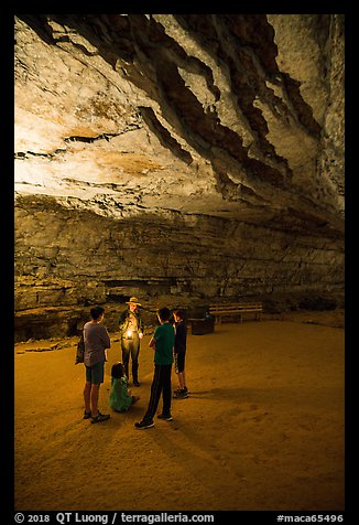 Ranger with lantern talks to family in cave. Mammoth Cave National Park (color)