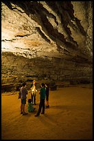 Ranger with lantern talks to family in cave. Mammoth Cave National Park ( color)