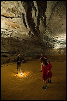 Ranger talking to family in cave. Mammoth Cave National Park ( color)