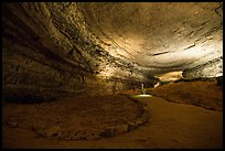 Visitors walk down huge corridor in cave. Mammoth Cave National Park ( color)
