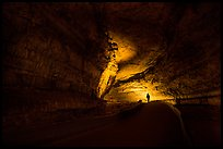 Ranger with lantern backlighted in dark cave corridor. Mammoth Cave National Park ( color)