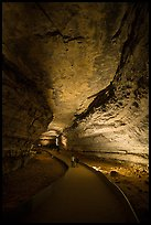 Visitors walk down path in cave. Mammoth Cave National Park ( color)