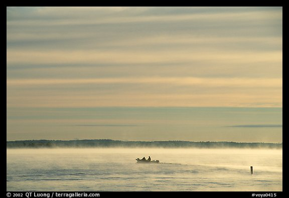 Boaters in fog, early morning, Kabetogama lake. Voyageurs National Park (color)