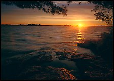 Sun rising over Kabetogama Lake. Voyageurs National Park, Minnesota, USA. (color)