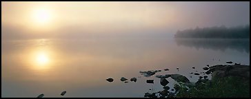 Misty lake scene with sun piercing fog. Voyageurs National Park (Panoramic color)