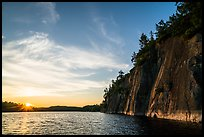 Sun setting and Grassy Bay Cliffs at sunset. Voyageurs National Park ( color)