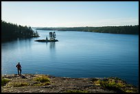 Visitor looking, Anderson Bay and Rainy Lake. Voyageurs National Park ( color)