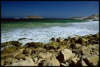 Surf foam and rocks, Cuyler Harbor, mid-day, San Miguel Island. Channel Islands National Park, California, USA.