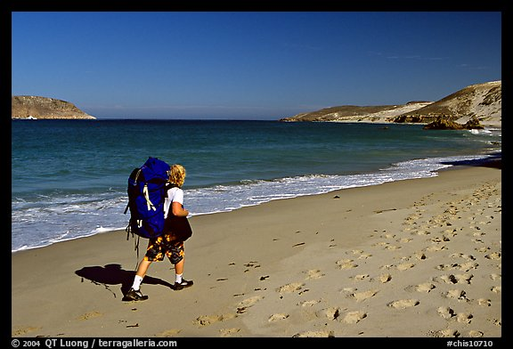 Backpacker on beach, Cuyler harbor, San Miguel Island. Channel Islands National Park (color)