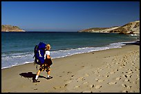 Backpacker on beach, Cuyler harbor, San Miguel Island. Channel Islands National Park, California, USA. (color)