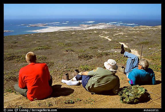 Hikers observing Point Bennett from a distance, San Miguel Island. Channel Islands National Park (color)