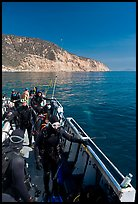 Divers in full wetsuits on diving boat, Santa Cruz Island. Channel Islands National Park, California, USA. (color)