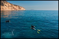 Scuba divers on ocean surface, Santa Cruz Island. Channel Islands National Park, California, USA. (color)