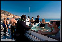 Divers in hot tub aboard the Spectre dive boat, Santa Cruz Island. Channel Islands National Park ( color)