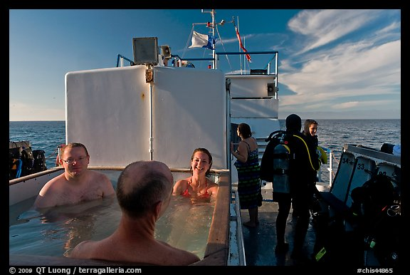Soaking in hot tub on diving boat, Annacapa Island. Channel Islands National Park (color)