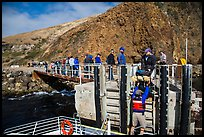 Unloading via human chain, Scorpion Anchorage, Santa Cruz Island. Channel Islands National Park ( color)