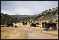 Tents pitched in wind shelters, Santa Rosa Island. Channel Islands National Park ( color)