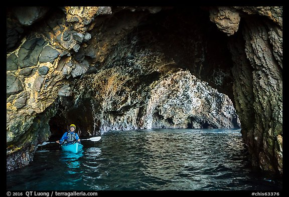 Kayaker in sea cave, Santa Cruz Island. Channel Islands National Park (color)