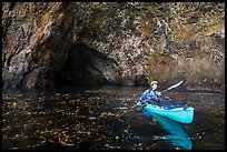 Kayaker paddling out of sea cave, Santa Cruz Island. Channel Islands National Park ( color)