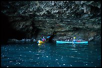Two kayakers in sea cave with low ceiling, Santa Cruz Island. Channel Islands National Park ( color)