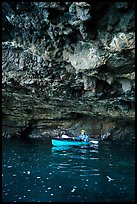 Kayaker in sea cave with low ceiling, Santa Cruz Island. Channel Islands National Park ( color)