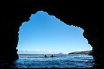 Looking out sea cave entrance with distant sea kayakers, Santa Cruz Island. Channel Islands National Park ( color)