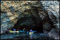 Kayakers at the entrance of sea cave, Santa Cruz Island. Channel Islands National Park ( color)