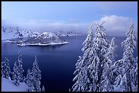 Wizard Island and Lake at dusk in winter. Crater Lake National Park, Oregon, USA.