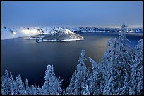 Trees, Lake and Wizard Island, winter sunrise. Crater Lake National Park, Oregon, USA.