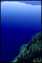 Trees and blue lake waters. Crater Lake National Park, Oregon, USA. (color)