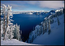 Snow-covered trees and dark lake waters. Crater Lake National Park ( color)