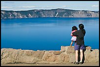 Woman and baby looking at Crater Lake. Crater Lake National Park, Oregon, USA. (color)