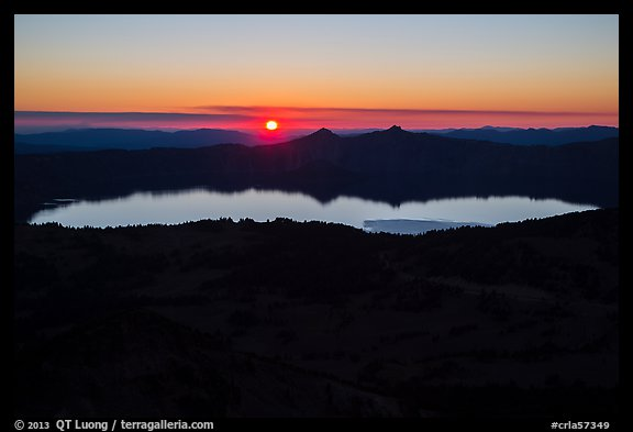 Wide view from Mount Scott of sun setting over Crater Lake. Crater Lake National Park (color)