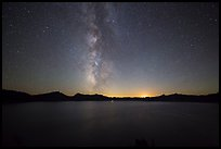 Milky Way and Crater Lake with setting moon. Crater Lake National Park, Oregon, USA.