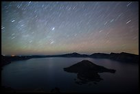 Star trails over Crater Lake and Wizard Island. Crater Lake National Park, Oregon, USA.