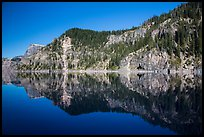 Cliffs reflected in calm waters. Crater Lake National Park ( color)