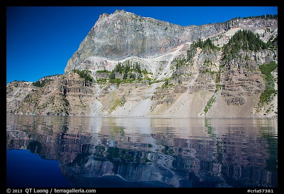 Llao Rock reflected in rippled water. Crater Lake National Park (color)