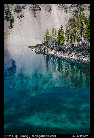 Watchman reflection in clear water of Fumarole Bay, Wizard Island. Crater Lake National Park (color)