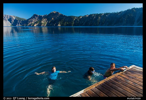 Girls swim from Wizard Island dock. Crater Lake National Park (color)