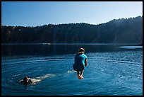 Girl jumps in water in Governors Bay, Wizard Island. Crater Lake National Park ( color)