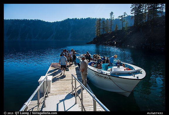 Visitors embark on tour boat at Wizard Island boat dock. Crater Lake National Park (color)