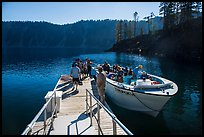 Visitors embark on tour boat at Wizard Island boat dock. Crater Lake National Park ( color)