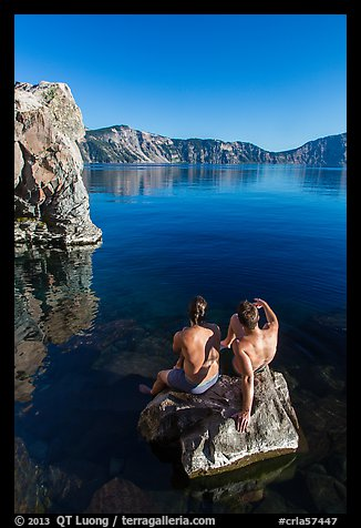 Men sunning on rock, Cleetwood Cove. Crater Lake National Park (color)