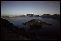 Wizard Island and lake with moonlight. Crater Lake National Park, Oregon, USA.