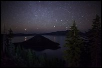 Trees, Wizard Island and lake at night. Crater Lake National Park, Oregon, USA.