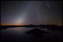 Glow from dawn and starry sky. Crater Lake National Park, Oregon, USA.